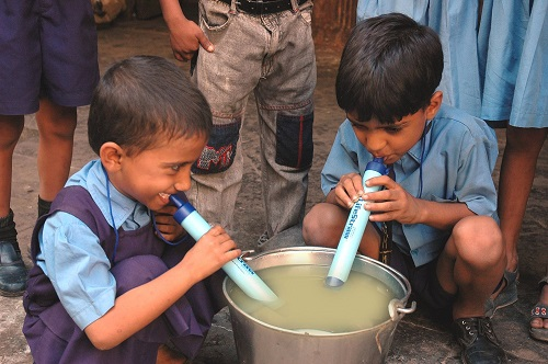 Two Boys Using LifeStraw Personal Water Filter